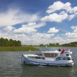 Europa , Polen , Ostpreussen , Masuren , Masurische Seenplatte , Hausboot auf dem Talter Gewaesser